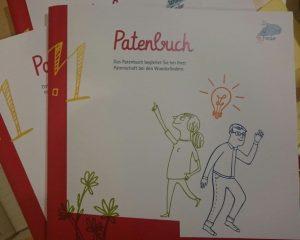Auf dem Bild ist das Cover des Patenbuches zu sehen.